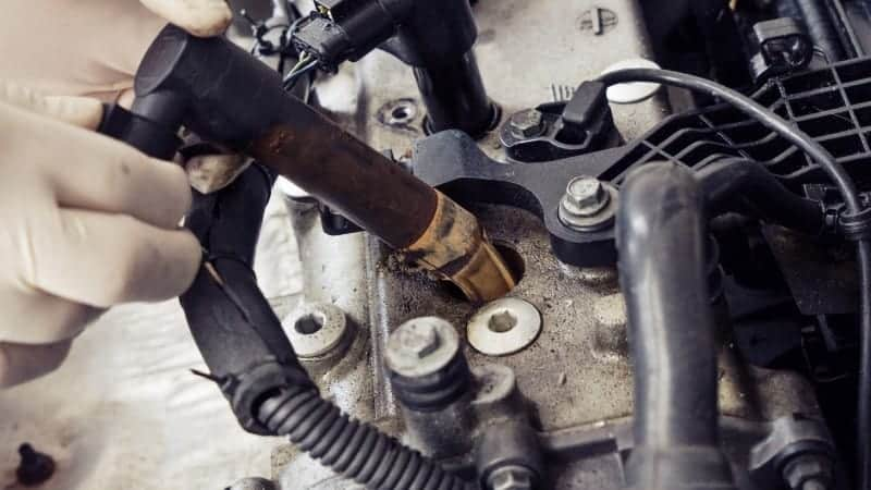 how to clean spark plug hole without compressed air