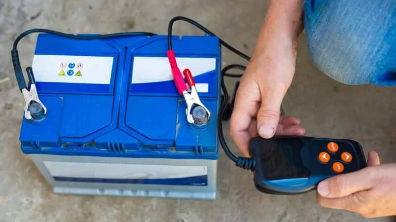 how many volts is a car battery while running